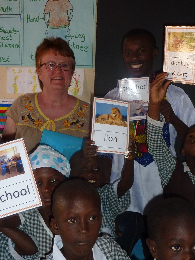 Bernard class teacher at nursery with Gill, children and new flashcards made and donated by Alfreton Nursery School, Derbyshire.