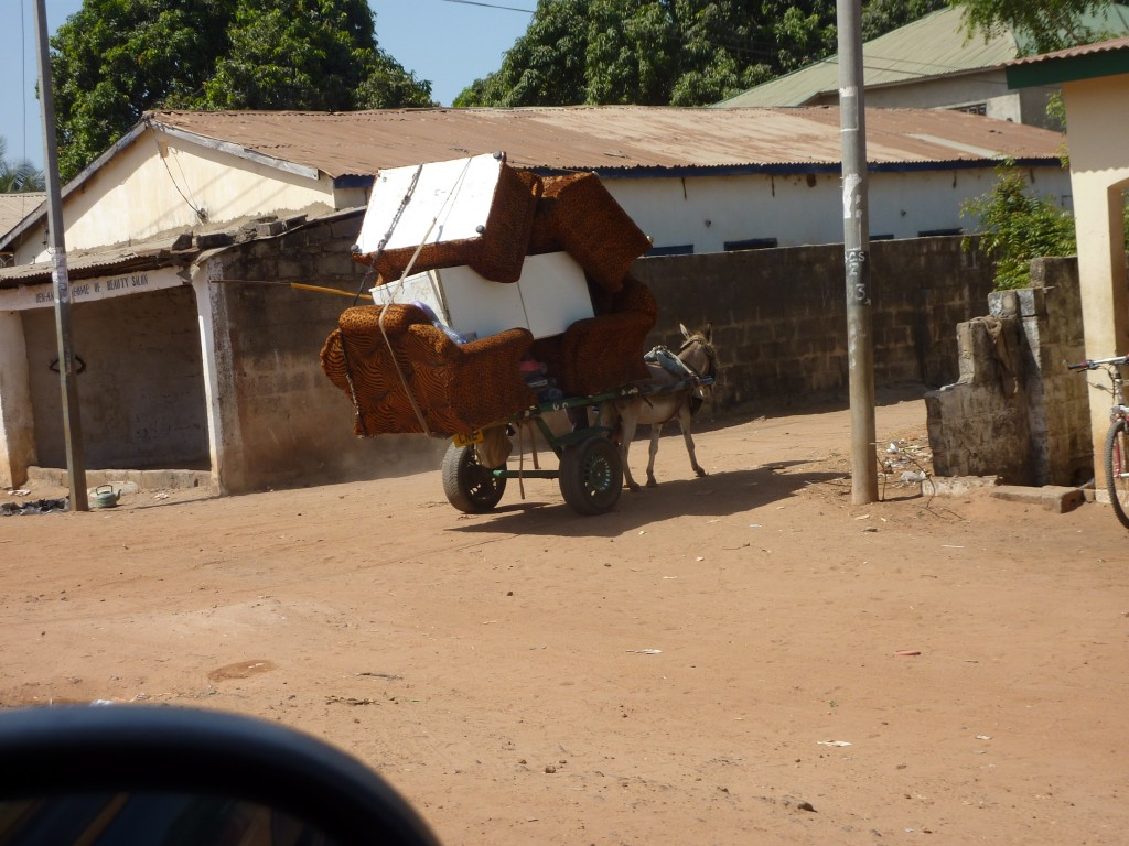 Moving house on a donkey and cart.