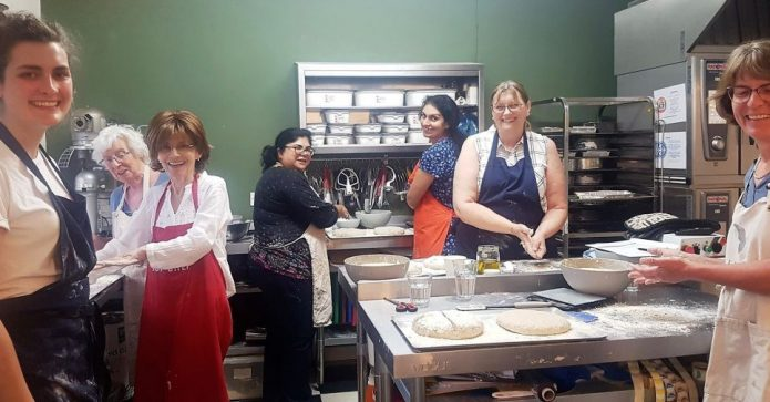 May 2018 - East London Club having bakery lesson at partner organisation, which works with vulnerable women.