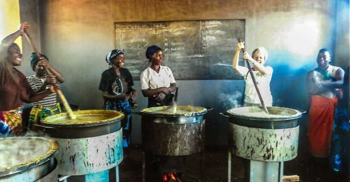 October Winner SI Heswall in the school kitchen she funded in Malawi