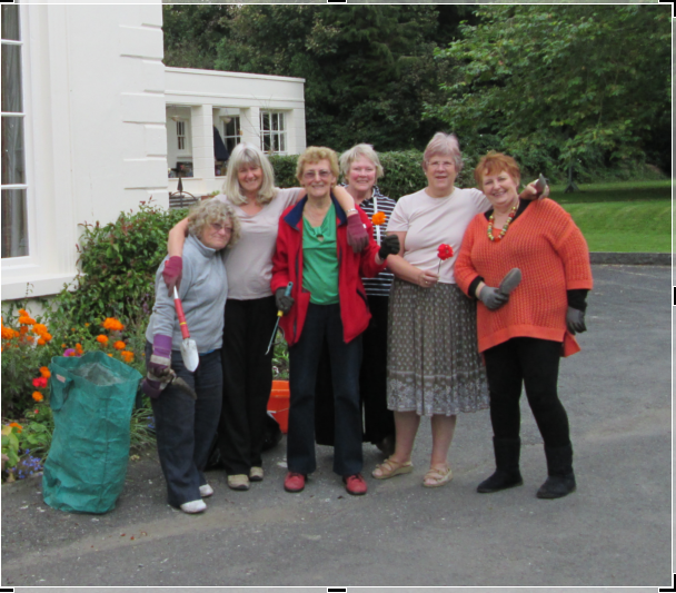 Members adopted and maintain the front flower garden of Pilton House Residential Home and are pictured after planting spring bulbs.