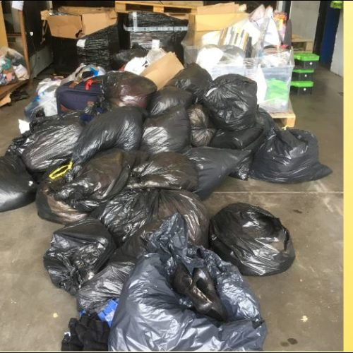 36 BAGS OF USED CLOTHING READY TO BE SORTED FOR THE KNICKRS FOR KNOWLEDGE PROJECT