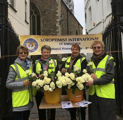 SORPTIMIST MEMBERS GAVE OUT CREAM ROSES TO WOMEN ON INTERNATIONAL DAY
