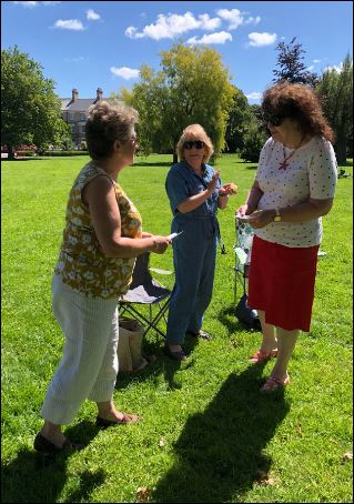 President Carolanne performed an out door induction ceremony in Rock Park to welcome new member Louise to the club.