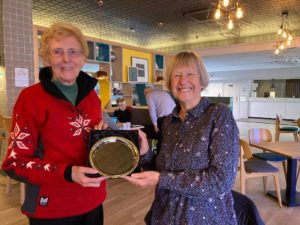 Diane Hill presenting the Ellen Braun trophy to Jenny Arnold of SI Barnstaple for winning the South West and Channel Island programme Action Award.