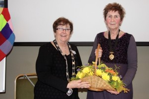 President Sue presents a basket of flowers to IPP Bethan