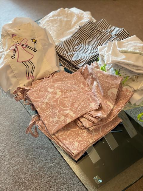 pile of scrubs bags made by Bridgend Soroptimists