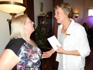 Diane presenting a birthday gift to President Astrid of SI Gluckstadt