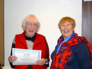 Elizabeth James (l) receives 40years service certificate