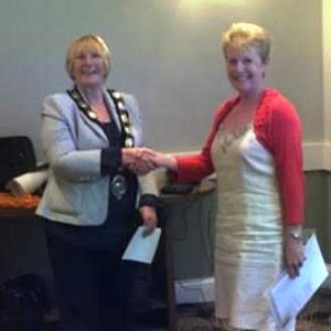 President Ann welcomes and inducts new member Ruth Evans