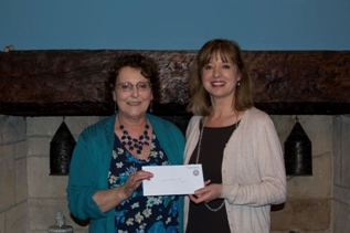 President Marietta presenting cheque to Jenny from GDA