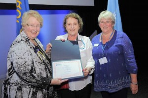 SI Cirencester members Marietta and Judith collecting the award for Programme Action From Federation President