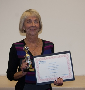 Competition organiser Margaret Munroe with the Soroptimist International award for organising the Literacy Competition.
