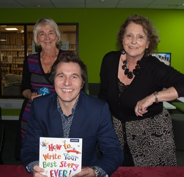Competition organisers Margaret Munroe and Marietta Crockford with author Christopher Edge
