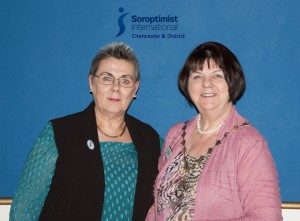 Immediate Past President Kathy hands over to President Pat