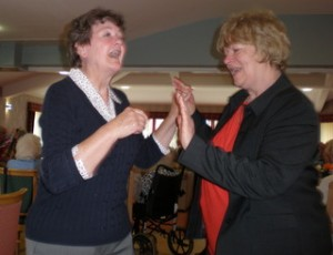 Left to Right: Maureen and President Linda enjoying dancing to Singing In The Rain