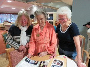 Carole, Roula and Jean with the 1998 scrap book.