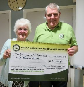 President Alma presents cheque to Steve Cooper
