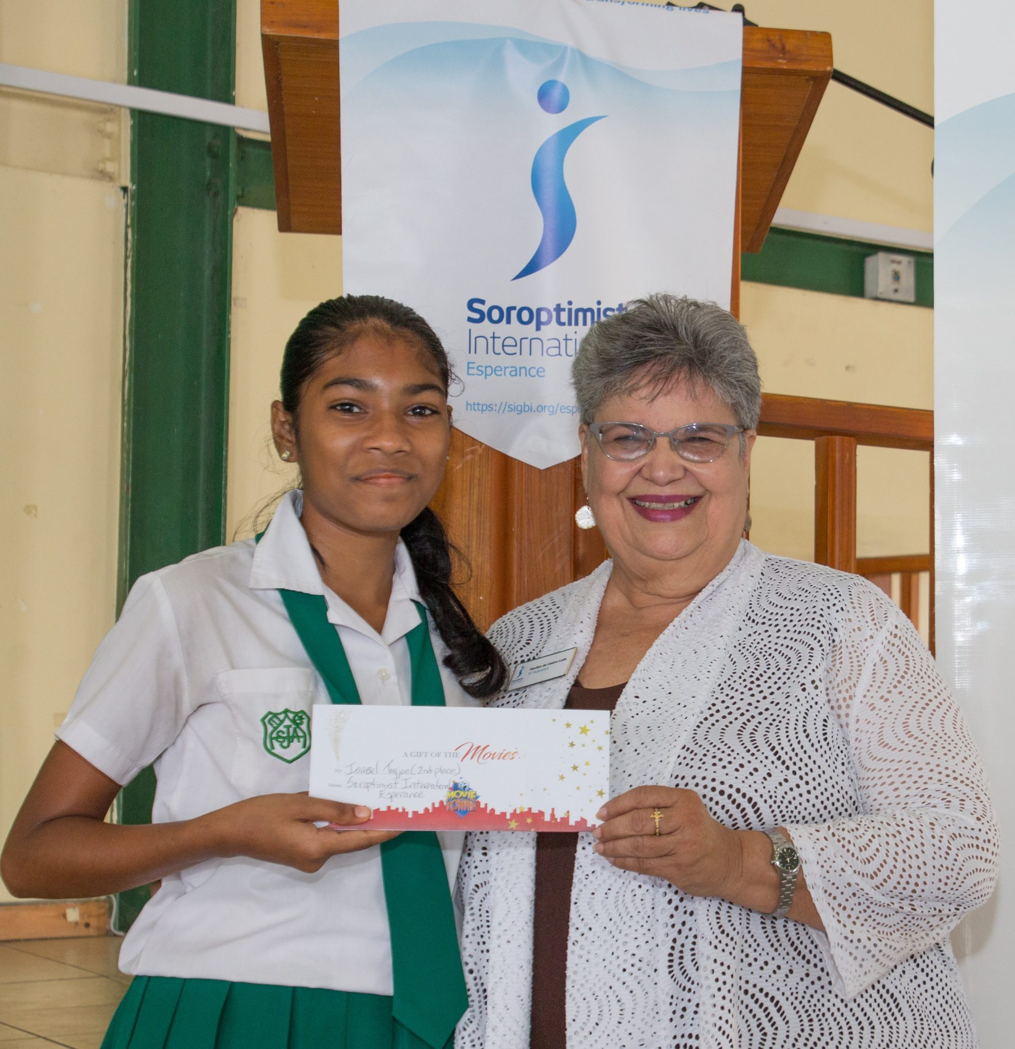 Communications Officer Marilyn Lalla presents the prize to 1st place winner Ivory Reid.