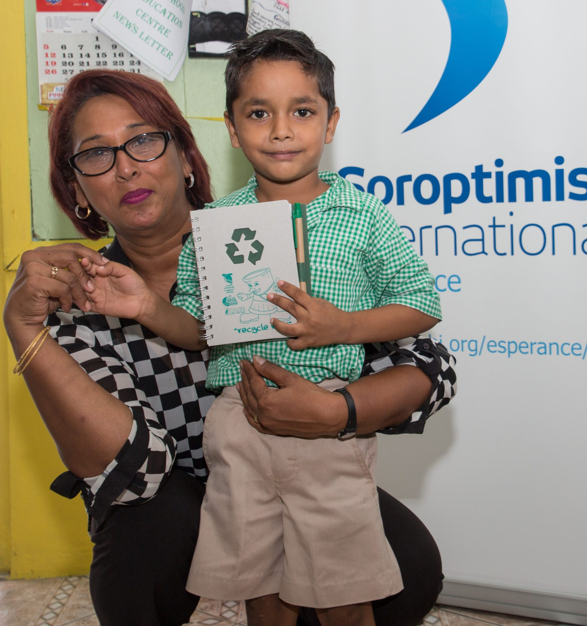 Principal Annie Rajkumar receives her Recycle Now notebook presented by her student.