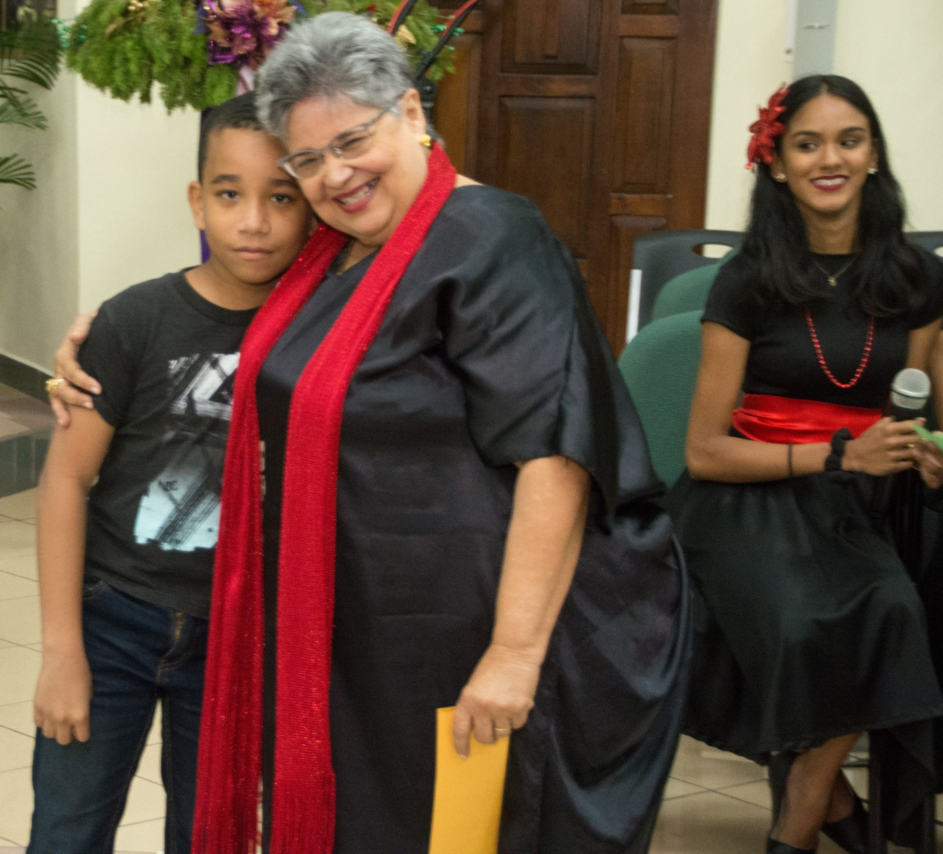 A Venezuelan child thanks Musical Director Soroptimist Marilyn Lalla.