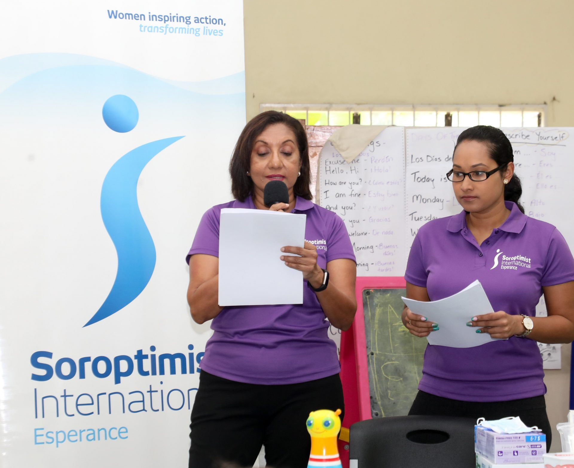 Dr. Arianne Dhanukdharriesingh (R) explains elements of dental hygiene and Fadia Muradali-Kumar translates.