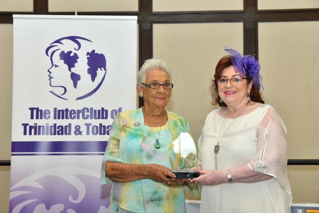 3 InterClub President Rabbia Khan presents the InterClub's IWD 2020 Award for Dedicated Volunteerism to Ursula de Castro