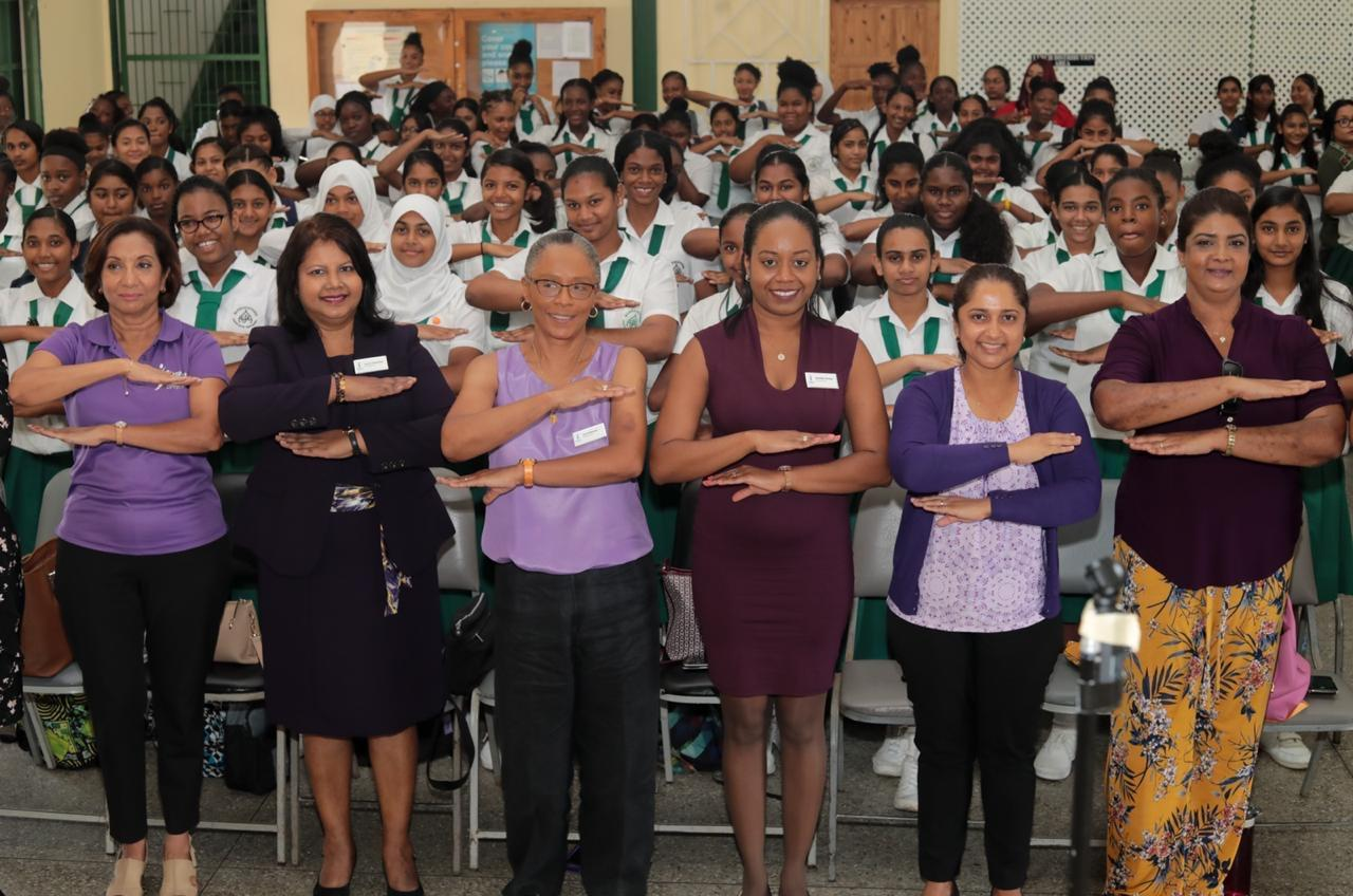 Soroptimists and girls display the #EachForEqual sign.