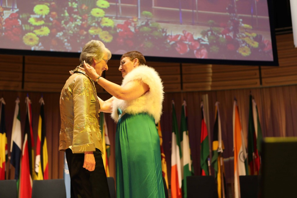 Pat Black presents Insignia to Margaret Oldroyd