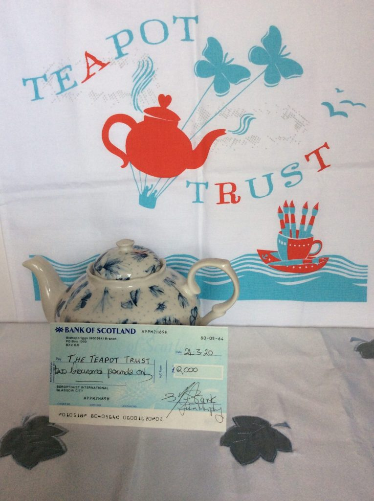 Donation cheque to the Teapot Trust from SI Glasgow City.