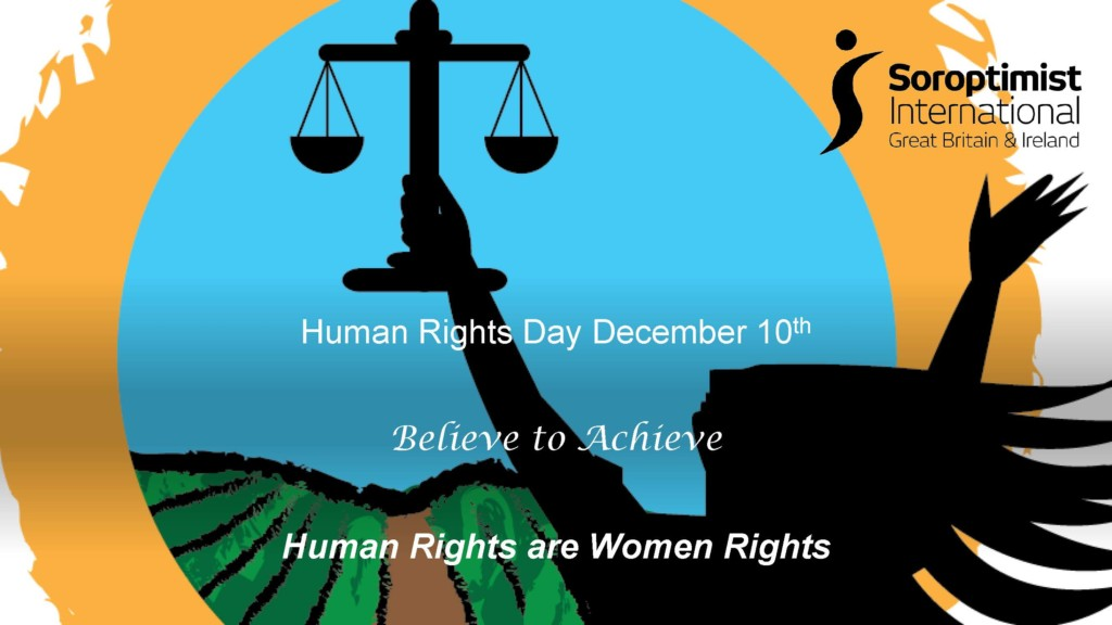 a woman holding a scales of justice - human rights are women rights