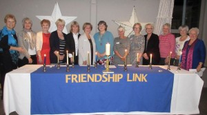 Club members light candles for our friendship links