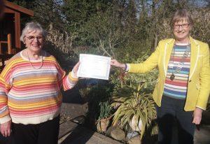 President Sandra presents Long Service Award to Dorothy Taylor