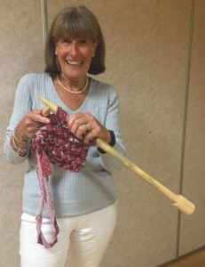 Angela St John gets to work with her giant knitting needles!
