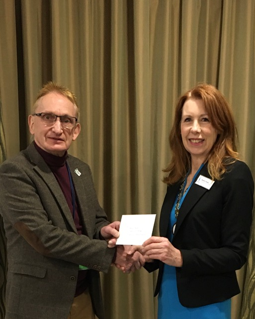 Andy Bower from Trussell Trust receiving cheque from President Sandra