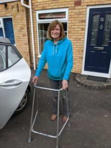 Younger woman with zimmer frame