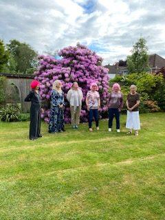 Group of 6 women in garden