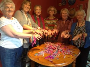 "Members with the friendship bracelets they have made for the ""Alternative Rite of Passage"" celebrations."