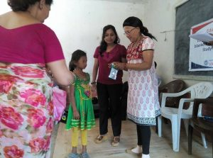 Pari Lama receiving her prize (wrist watch) for achieving top marks.