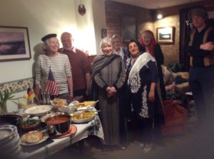 Supper with food from around the world and people in international dress