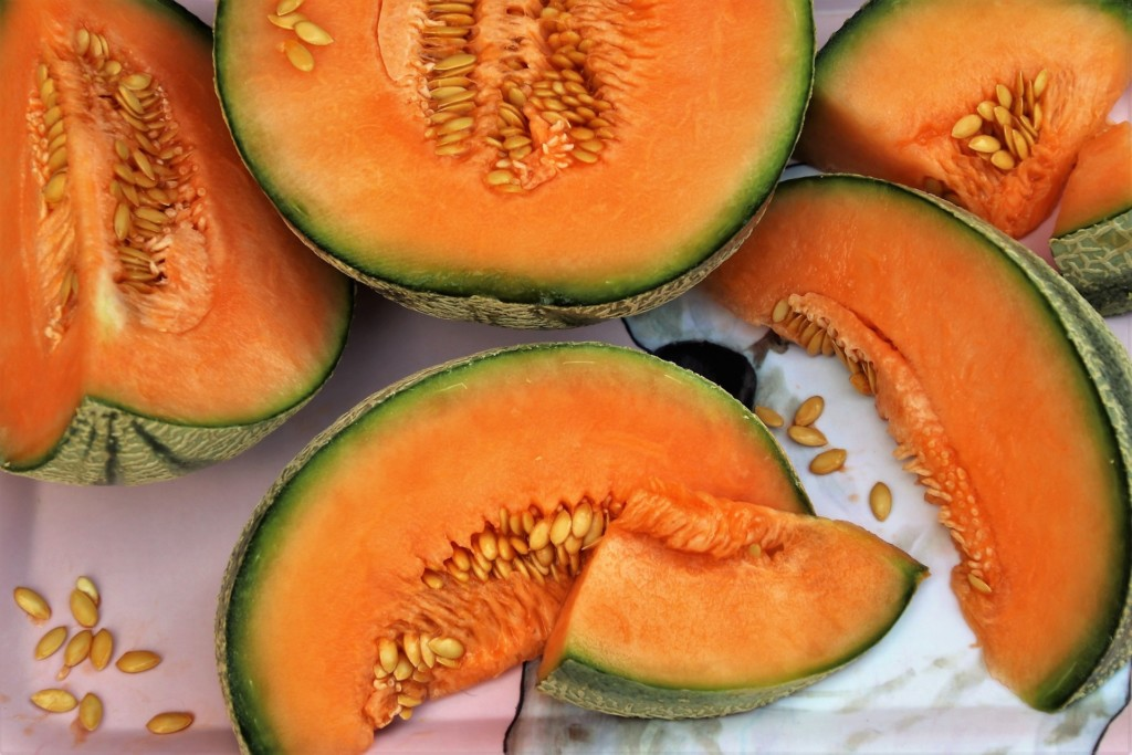 Image of melons cut in half and slices