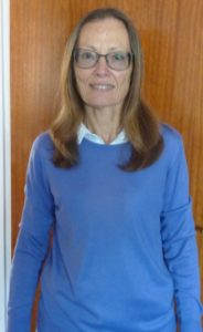 Photo of Karen Wearing the Blue Sweater which she made the subject of her report on sustainable fashion