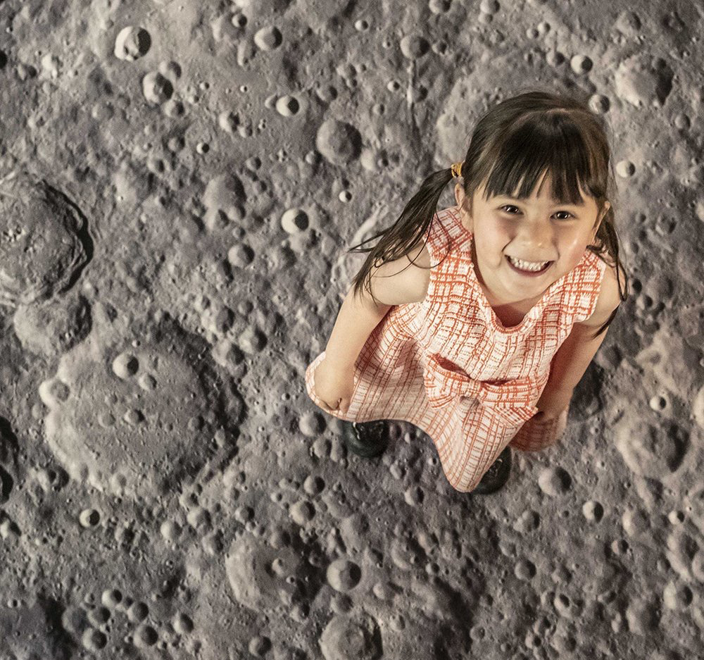 International Day of Human Space Flight -Photo of little girl apparently standing on the surface of the moon