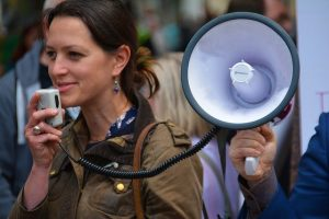 advocating for change - woman with megaphone
