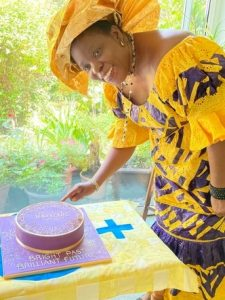 Rose Moriba Simbo Cutting the Cake