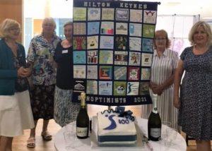 SI Milton Keynes 100 Cake and Members