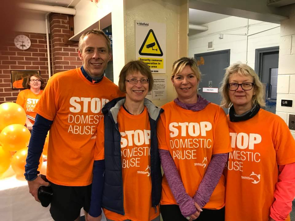 Member Claire Barber ready to Run in Orange