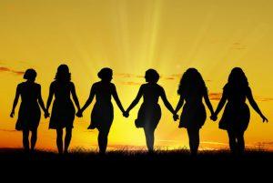 Image of women taken against a sunset