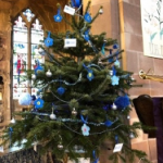 Christmas tree decorated in blue