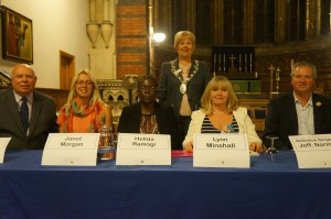 President Anne Ellis standing behind the Panel for the question and answer session during the 'Raising Awareness of Human Trafficking Event in Neath